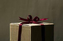 Bow of scarlet ribbon on gift box