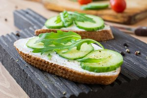 Healthy cucumber arugula toast