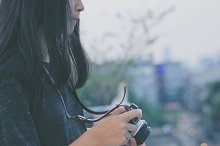 Young girl holding film camera