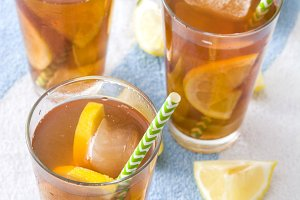 Ice tea with lemon on summer towel