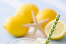 Ice tea with lemon on a beach towel