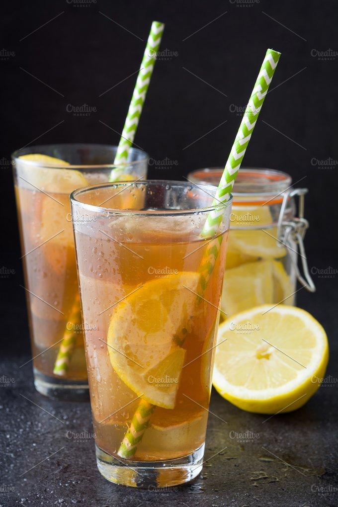 Ice tea with lemon. Black stone - Food & Drink