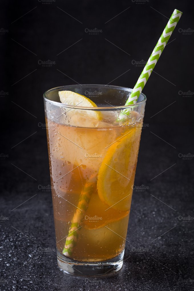 Ice tea with lemon. Black stone - Food & Drink