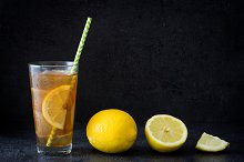 Ice tea with lemon. Black stone