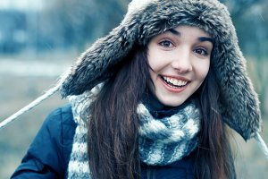 smiling girl in a winter hat
