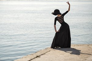 Ballerina in black dress dancing
