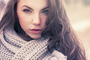 Portrait of a brunette in a scarf