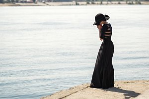 Ballerina in long black dress sad.