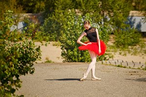 Ballerina in red tutu dancing
