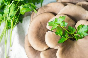 Raw mushrooms with parsley