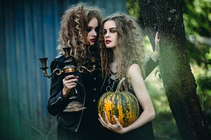 two vintage women as witches
