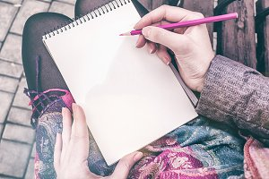 Youn girl writing in notebook