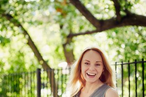 Laughing young woman in the park