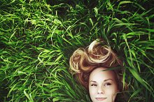 Meditative woman in the grass