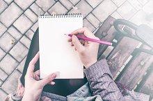 Girl writing on notebook mockup