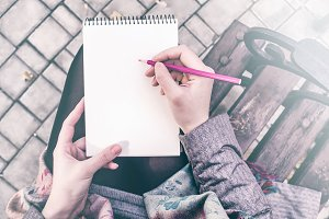 Girl writing on notebook mockup