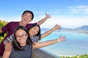 Family happy on viewpoint Phuket