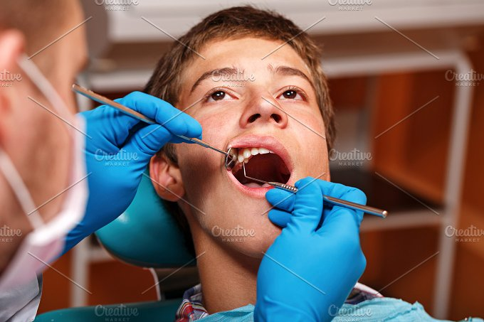 Dental clinic. Dentist at work - Photos