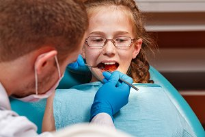 Pediatric dentist.