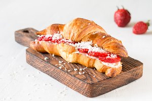 Sweet croissant with strawberry