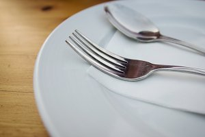 fork and spoon with white plate