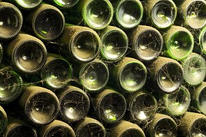 old wine bottles in wine cellar