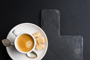 Espresso coffee cup and croissant