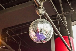 Silver disco ball in nightclub