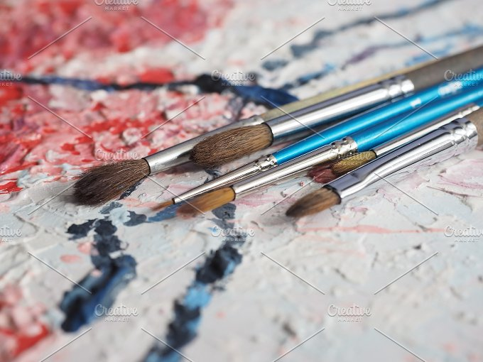 Paintbrushes on oil painting canvas. Shallow depth of field. - Arts & Entertainment