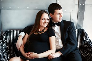 Young happy pregnant couple
