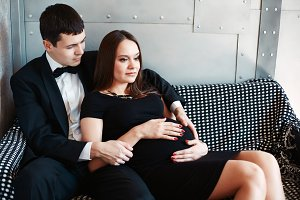 Elegant pregnant couple