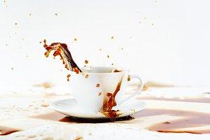 Spilling coffee creating splash