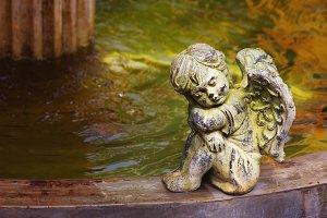 Cherub next to the fountain