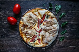 Cheese pie with tomato and basil