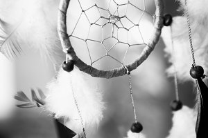 black and white photo dream catcher on multicolored background