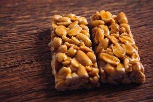 Kozinaki of peanut on a wooden background