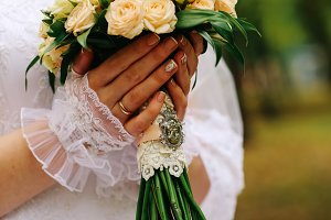 young bride holding a bouquet of flowers