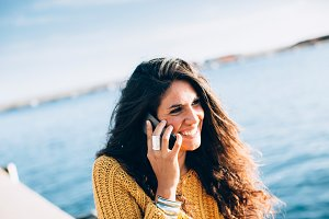 Smiling woman at phone