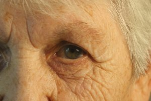 Closeup portrait of a old woman's gaze