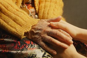 Old woman young woman hold hand wrinkle skin close up