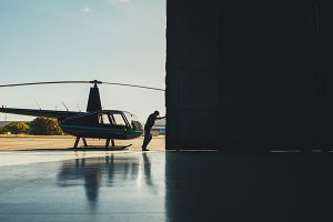 Pilot opening the helicopter hangar