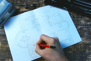 Architect signs room on the floor plan