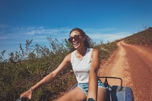 Young woman enjoying quad bike