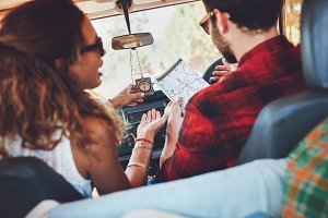 Couple using map on a roadtrip