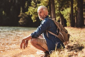 Senior male hiker relaxing