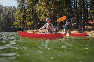 Mature couple having fun kayaking