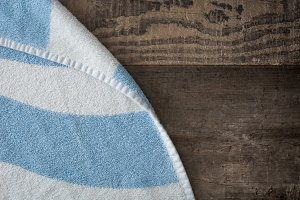 Beach towel on wooden background