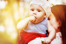 Beautiful cute baby girl in summer