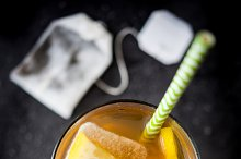 Ice tea with lemon. Black stone