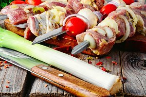 raw meat on skewer